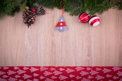Christmas ornaments with red ribbon, pine tree and cones. Christmas ornaments with pine tree, pine cones, some red and xmas silver balls with a red ribbon Royalty Free Stock Photo