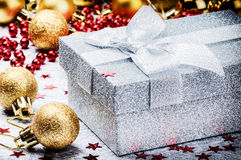 Christmas ornaments and present in silver  box Royalty Free Stock Photos