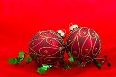 Christmas ornaments on red background Royalty Free Stock Photos