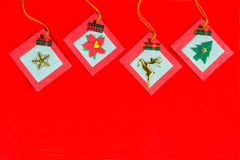 Christmas ornaments on red background Stock Photos