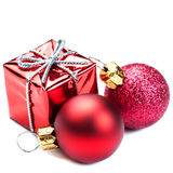 Christmas ornaments with Red gift box and balls  isolated on whi Stock Photography