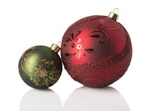 Christmas Ornaments. Red and green christmas ornaments on white royalty free stock photo