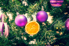 Christmas Ornaments in retro filter effect or instagram filter. Christmas Ornaments on a green Christmas Tree in retro filter effect or instagram filter Stock Photography