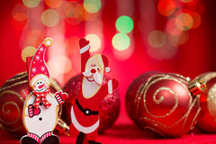 Christmas ornaments. Santa claus and sow man with blurry glitter shiny lights at background stock images