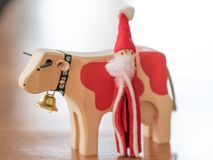 Christmas Ornaments Santa Claus Walking with a cow and bell Stock Photos