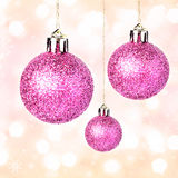 Christmas ornaments with shiny festive balls hanging on Gold Fes Stock Photography