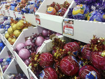 Christmas ornaments shop. Sale of Christmas decorations in a supermarket. Preparing for the Christmas holidays and the New Year Royalty Free Stock Photos