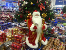 Christmas ornaments shop. Sale of Christmas decorations in a supermarket. Preparing for the Christmas holidays and the New Year.Santa Claus Royalty Free Stock Photo