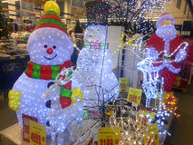 Christmas ornaments shop. Sale of Christmas decorations in a supermarket. Preparing for the Christmas holidays and the New Year. Santa Claus, snowman, deer Stock Photography