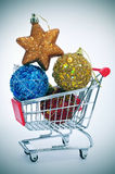 Christmas ornaments in a shopping cart Stock Photos
