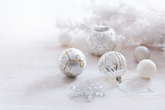 Christmas ornaments in silver and white over white background royalty free stock photo