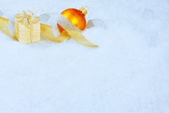 Christmas ornaments on a snow Royalty Free Stock Photo
