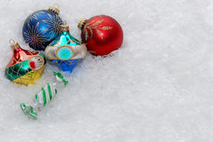 Christmas ornaments on snow Royalty Free Stock Image