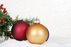 Christmas ornaments in snow. Closeup of Christmas ornaments in snow royalty free stock photo