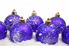 Christmas ornaments in snow Stock Photography