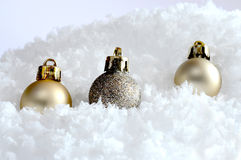 Christmas ornaments in the snow Stock Photo