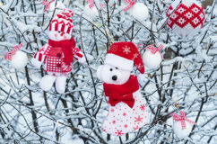 Christmas ornaments on snow covered tree branches royalty free stock image