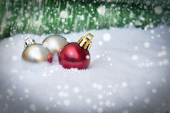 Christmas ornaments On Snow. Christmas decoration background, swon, ornaments Royalty Free Stock Image