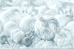 Christmas ornaments on snow Royalty Free Stock Photos