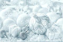 Christmas ornaments on snow royalty free stock photos