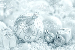 Christmas ornaments on snow Stock Photography
