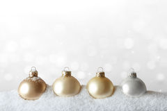 Christmas ornaments snow gold white Stock Images