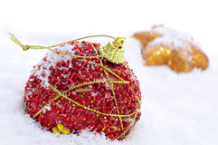 Christmas ornaments on the snow Stock Images