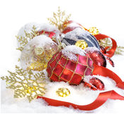Christmas ornaments  in the snow with red ribbon Royalty Free Stock Images
