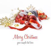 Christmas ornaments  in the snow with red ribbon Stock Image