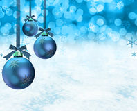 Christmas ornaments snow scene. Christmas ornaments on a snow background Royalty Free Stock Photo