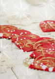 A Christmas ornaments. Christmas table decoration with hearts Stock Photos