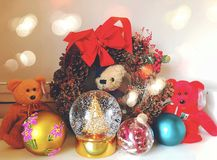 Christmas ornaments. Teddy bears toys and crystal snowglobe for Christmas ornaments decorations in united states Royalty Free Stock Photography