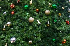 Christmas ornaments on a tree Royalty Free Stock Image