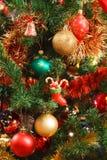Christmas ornaments on tree stock photos