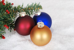 Christmas ornaments and tree branch Royalty Free Stock Image