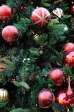 Christmas ornaments on tree stock photography