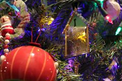 Christmas Ornaments on Tree. Close Up of Holiday Decorations royalty free stock photos