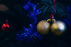 Christmas ornaments. Christmas tree decorations on a tree with globes, tinsel and bells Stock Photo