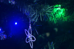 Christmas ornaments. Christmas tree decorations on a tree with globes, tinsel and bells Royalty Free Stock Image
