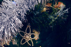 Christmas ornaments. Christmas tree decorations on a tree with globes, tinsel and bells Stock Image