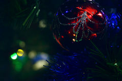 Christmas ornaments. Christmas tree decorations on a tree with globes, tinsel and bells stock photos