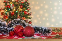 Christmas ornaments with tree and festive bokeh lighting, blurred holiday background royalty free stock images