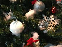 Christmas Ornaments on Christmas Tree. Ornaments hanging on Holiday/Christmas Tree stock images