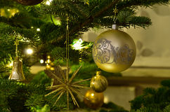Christmas ornaments. Christmas tree with several golden ornaments Stock Photos