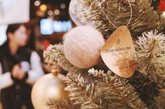 Christmas ornaments on tree in store