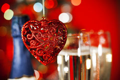 Christmas ornaments and two glasses of champagne Royalty Free Stock Image