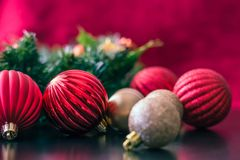Christmas ornaments wait on the table to be hung up around the house. royalty free stock image