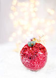 Christmas ornaments on white snow. Christmas lights and copy spa Stock Images