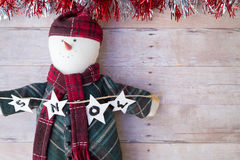 Christmas ornaments on a wood background Royalty Free Stock Images
