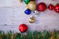 Christmas ornaments on a wood background Royalty Free Stock Image